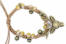 cute bronze coloured deer bracelet, adjustable, green colured thread and beads