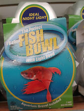1 GALLON FISH BOWL,COME WITH LIGHTED HOOD.7 WATT BULD,GRAVEL.JUST AD WATER,FISH