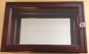 Antique Mahogany or Walnut Back Mirrored Cabinet by  American Cabinet Company