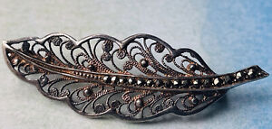 Old silver filigree and marcasites brooch