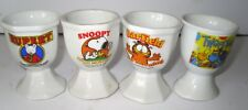 4 vintage egg cups Rupert, Tweenies, Garfield, Snoopy