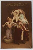Christmas Girls Posing with Santa & Toys Tucks Coloured Carbonette Postcard F13