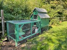 Large Chicken Coop with Small Run can include chickens. Big wooden hen house.
