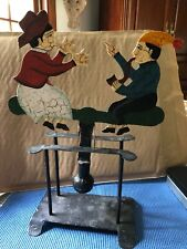 Folkart Metal Painted Man Smoking Pipe Lady Holding Hands Up W/ Counterweight