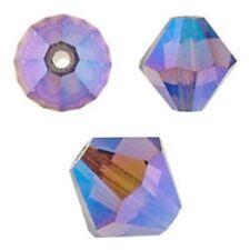 Swarovski Crystal Bicone Amethyst. AB 2X 6mm. Approx. 48 PCS. 5328