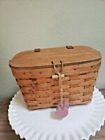Longaberger Basket with a lid and handles, 1993