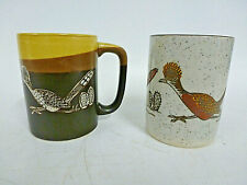 TWO DIFFERENT CERAMIC MUGS SHOWING PICTURE OF A ROADRUNNER BIRD AND CACTUS