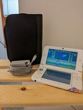 Nintendo 3DS XL pink with case pens and charger. Missing joystick nub