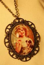 Lovely Scalloped Brasstone Little Girl Holding a Puppy Dog Glass Cameo Necklace