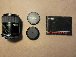 Vivitar 28-70mm f/3.5-4.8 Lens with haze filter. For Nikon cameras.