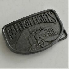 RALEIGH LIGHTS BELT BUCKLE 1970's SEMI TRUCK / TRUCKER TOBACCIANA good used