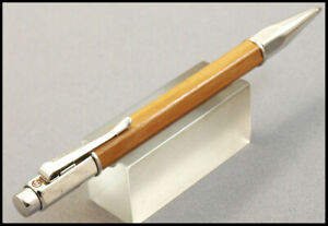 CARAN D'ACHE VARIUS METWOOD AND SILVER BALLPOINT PEN
