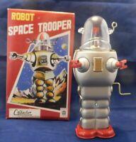 Robot mécanique en tôle. ROBOT SPACE TROOPER. Modèle gris - Ht 25 cm - neuf
