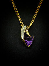 9CT YELLOW GOLD PENDANT SET WITH CUSHION TRILLION CUT AMETHYST AND DIAMONDS