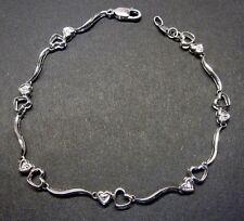 10k White Gold Diamond Heart link bracelet.