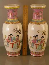 PAIR OF FAMILLE ROSE FIGURAL MIRROR IMAGE VASES MARKED