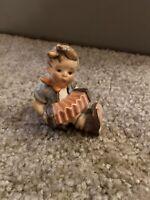 GOEBEL FIGURINE - BOY SITTING PLAYING ACCORDIAN - W. GERMANY