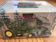 Ertl 1/64 die-cast metal John Deere Model A with Farmer 50th Anniversary Edition