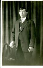 REAL PHOTO POSTCARD OF A MAN TAKEN IN A STUDIO 1920-1930 ERA IS MY GUESS