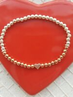 rose gold and silver plated stretchy stacking bracelet with heart bead