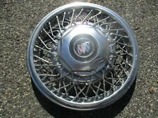 one 1992 Buick Lesabre Park Avenue Regal 15 inch wire spoke hubcap dented beater
