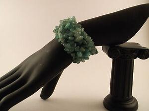 Various stretch gemstone chip bracelets.