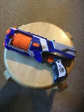 Pre Owned Nerf N-Strike Strong Arm Hand Gun.  Works Well.