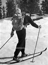 Old Photo.  Man Cross Country Skiing With Son In Backpack