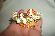 Two Puppies with flowers in a metal & ceramic basket pill container