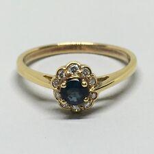 14 Karat Yellow Gold Round Sapphire and Diamond Ring