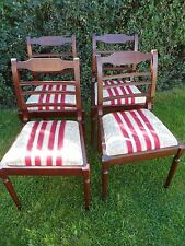 4 Dark wooden dinning chairs with insert pattern,red/white.gold material seats