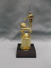 cast metal pistol shooter at toilet trophy metal column black marble base