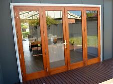 TIMBER BIFOLD DOORS,SOLID CEDAR,NEW 2700x2100h WITH PLEATED FLYSCREEN, IN STOCK