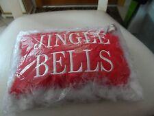 Red Jingle Bells pillow edged with white maraboo feather and a bell