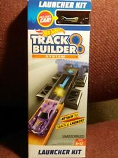 HOT WHEELS LAUNCHER KIT TRACK BUILDER SYSTEM INCLUDES CAR WITH RED LINE WHEELS