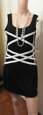 Ladies black short dress with white details on front a sleeveless dress size 14