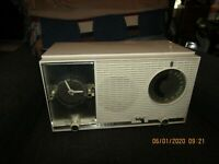 As Is 1950s working Zenith Model L727 AM/FM Clock Radio w/orig. booklet.