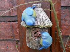 Latex mould of birds on a birdhouse