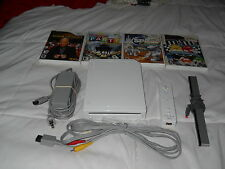 Wii+instruction manuel+wii remote + nunchuk + 4 games