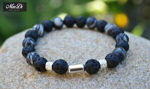Stretch bracelet with sterling silver, black veined jasper & lava stone.