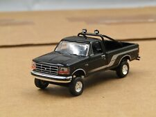 dcp/greenlight CUSTOM lifted 1992 Ford F150 black/silver 1/64.