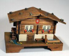 "Vintage Swiss Chalet Music Box plays ""Somewhere My Love"" w/ moving wheel"