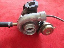 Original Alfa Romeo 75 1,8 turbo tipo 162b turbocompresor 60567271 expositor formaci.