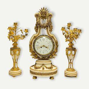 Vincenti et Cie Louis XVI Style Lyre Form Mantle Clock and Candelabra