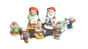 Vintage Santa Clause Figurines Christmas Skating Children Playing Ceramic Decor