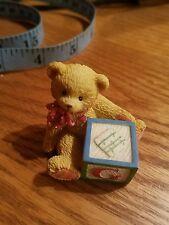 cherished teddies bear with a block