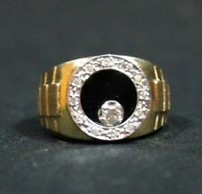 Man's 14Kt Gold Onyx and Diamond Ring .25 CT Total Weight