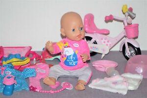 Baby Born Mädchen v. Zapf, 43 cm, Fahrrad, schöne Kleidung  + Zubehör
