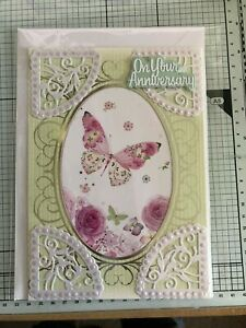 ANNIVERSARY, HANDMADE COLORFUL FLOWERS/BUTTERFLIES & SILVER EMBOSSED DETAIL CARD