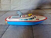 Ancien jouet en tôle à remontoir mécanique-bateau de police lithographié à clé